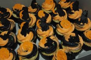 vanilla cupcake, strawberry preserve stuffing, black and orange vanilla butter icing, fondant halloween decorations