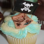 vanilla cupcake, blue and white butter icing, sugar paste, fondant treasure map, pirate theme