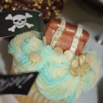 vanilla cupcake, blue and white butter icing, sugar paste, fondant treasure chest, gold coins, pirate theme