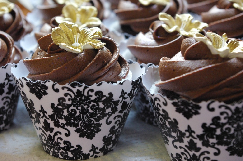 chocolate cupcake, chocolate butter icing, dusted gold fondant flower, black damask wrapper (collar)