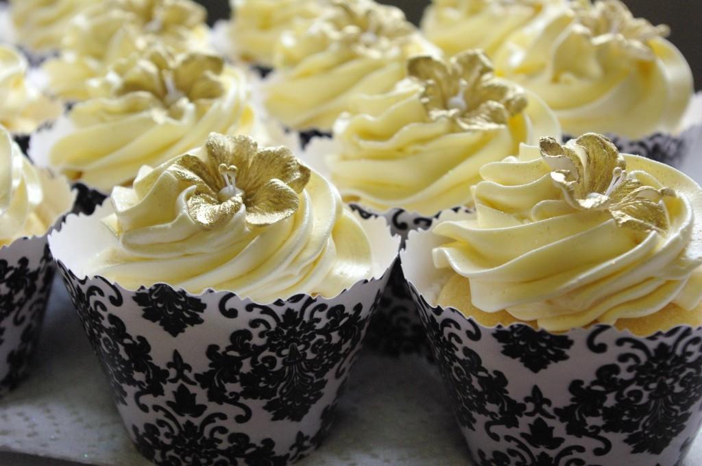 vanilla cupcake, custard buttercream, dusted gold fondant flower, black damask wrapper (collar)