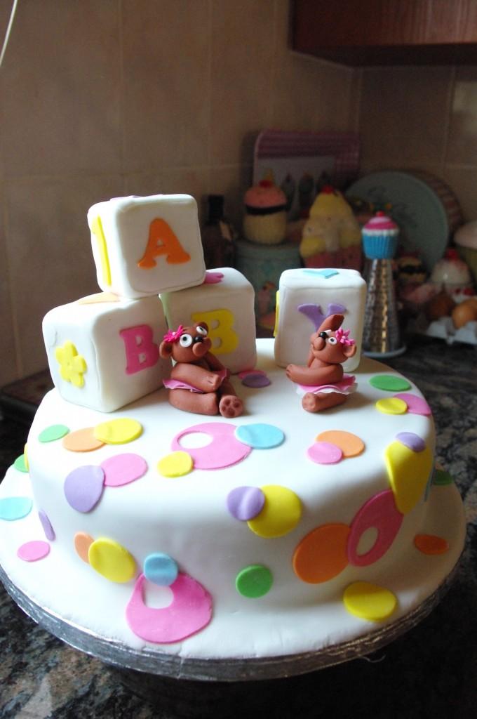 chocolate cake, chocolate ganache, white and pastel sugarpaste, hand made sugar paste bears