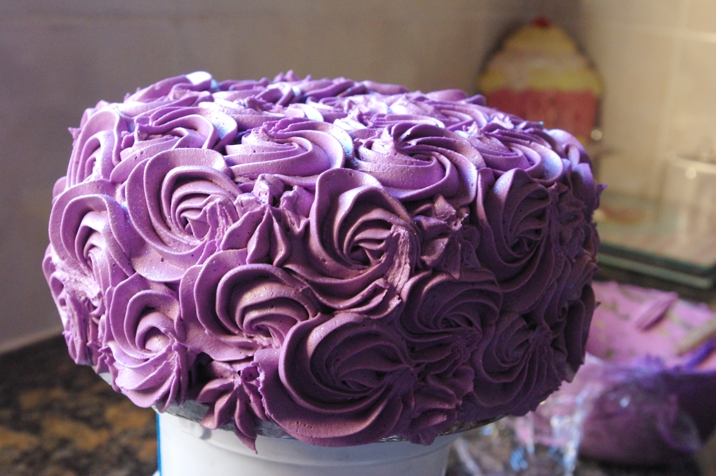 topped it with three little hand made sugarpaste roses that I made a ...