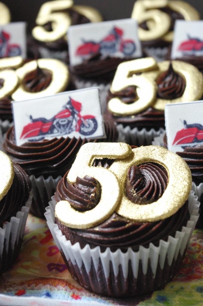 chocolate cupcaks, creme caramel secret centre, chocolate ganache, sugar paste decoration