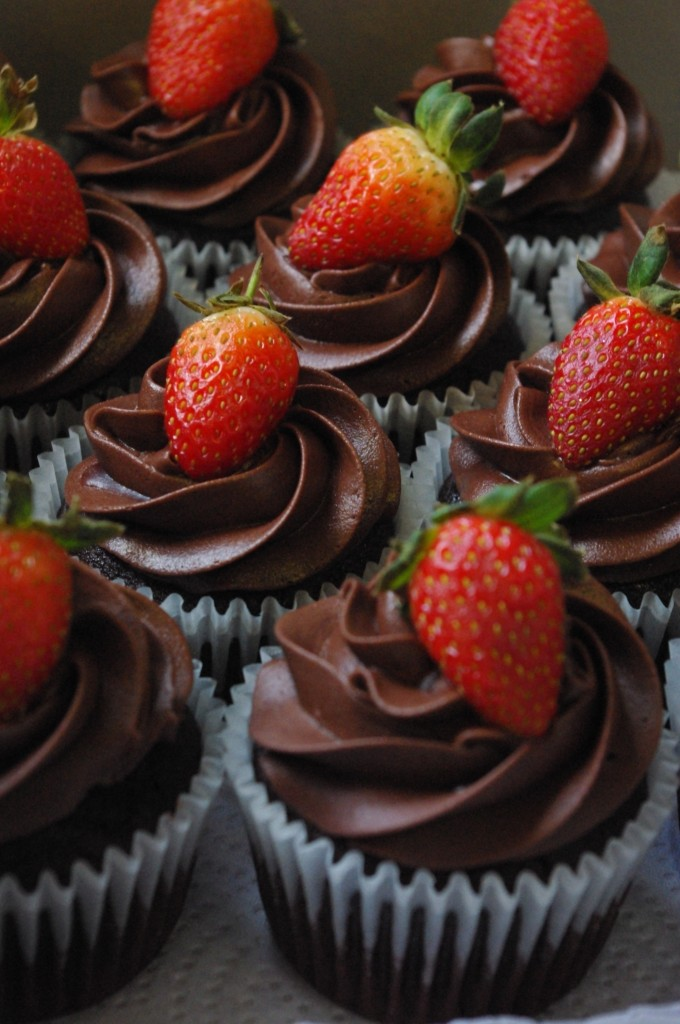 chocolate cupcakes, chocolate butter icing, fresh strawberry