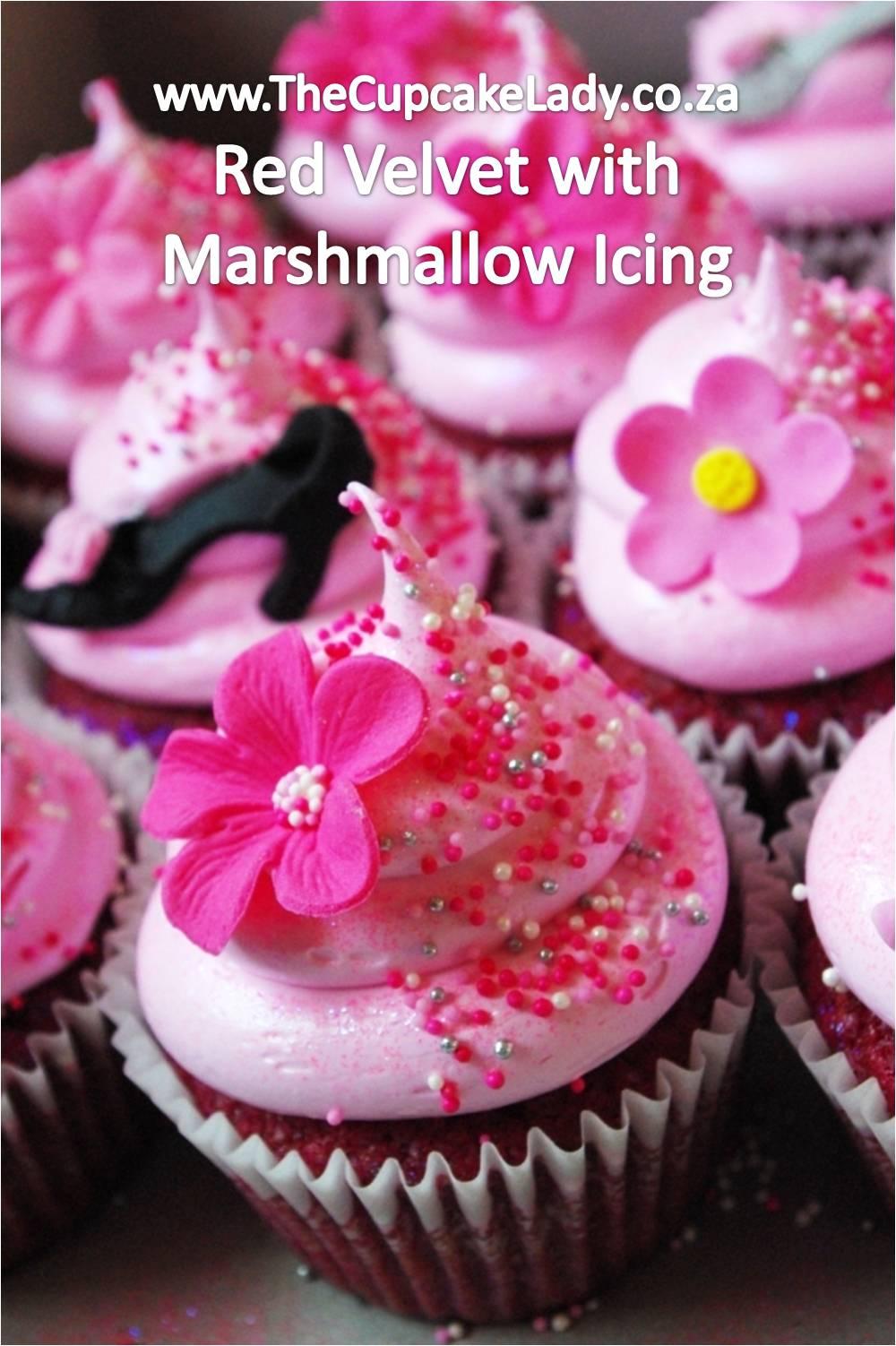 red velvet cupcakes, pink marshmallow icing, pink sprinkles, pink sugarpaste decorations, pink fondant decorations
