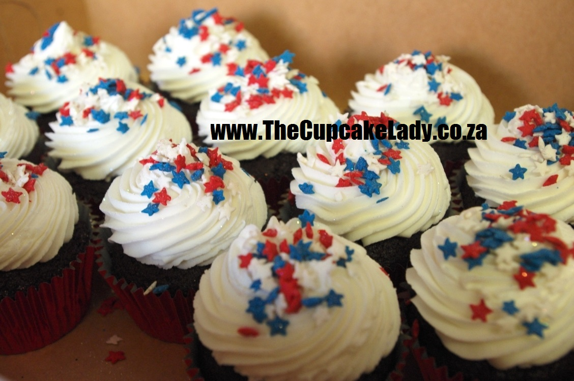 chocolate cupcakes, red paper cups, white vanilla butter icing, red white and blue sugarpaste star sprinkles