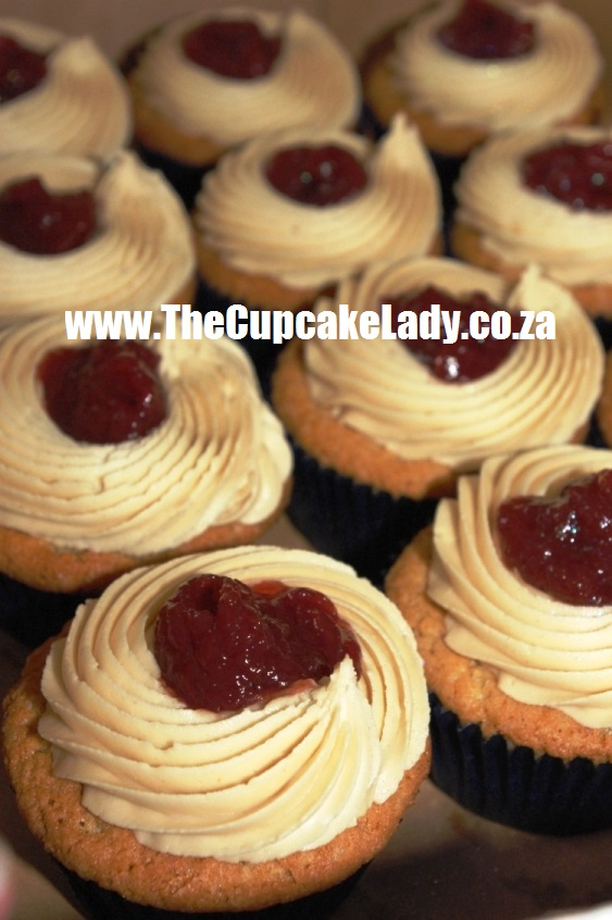 PB&J cupcakes, blue paper cups, peanut butter cupcakes, peanut butter icing, strawberry jam
