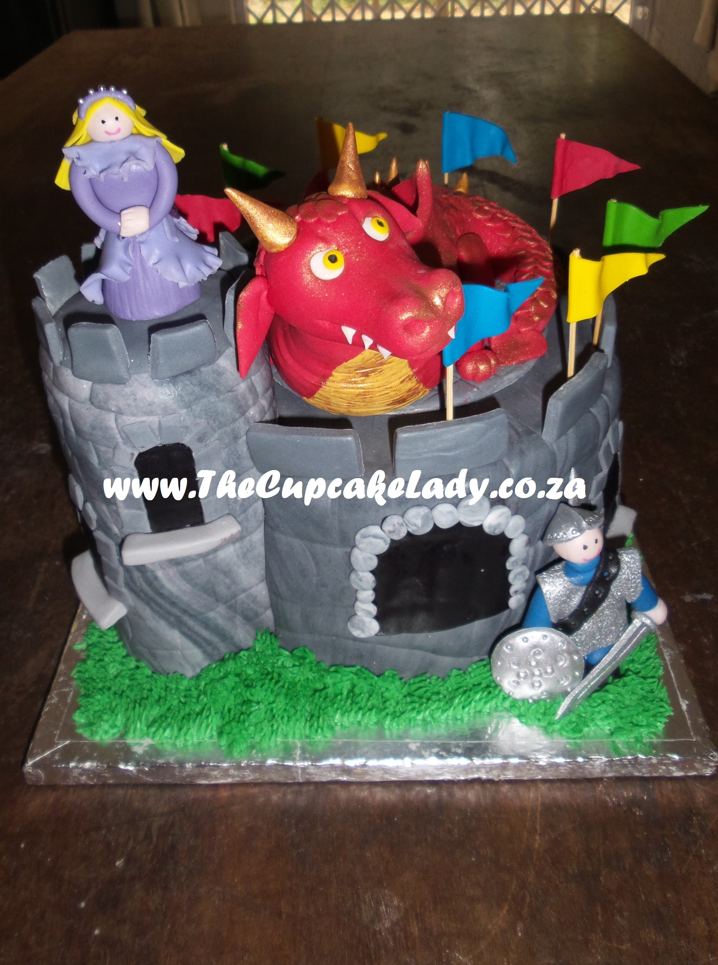 vanilla cake, sculpted cake, dragon cake topper, castle, knight, princess, hand made, custom made