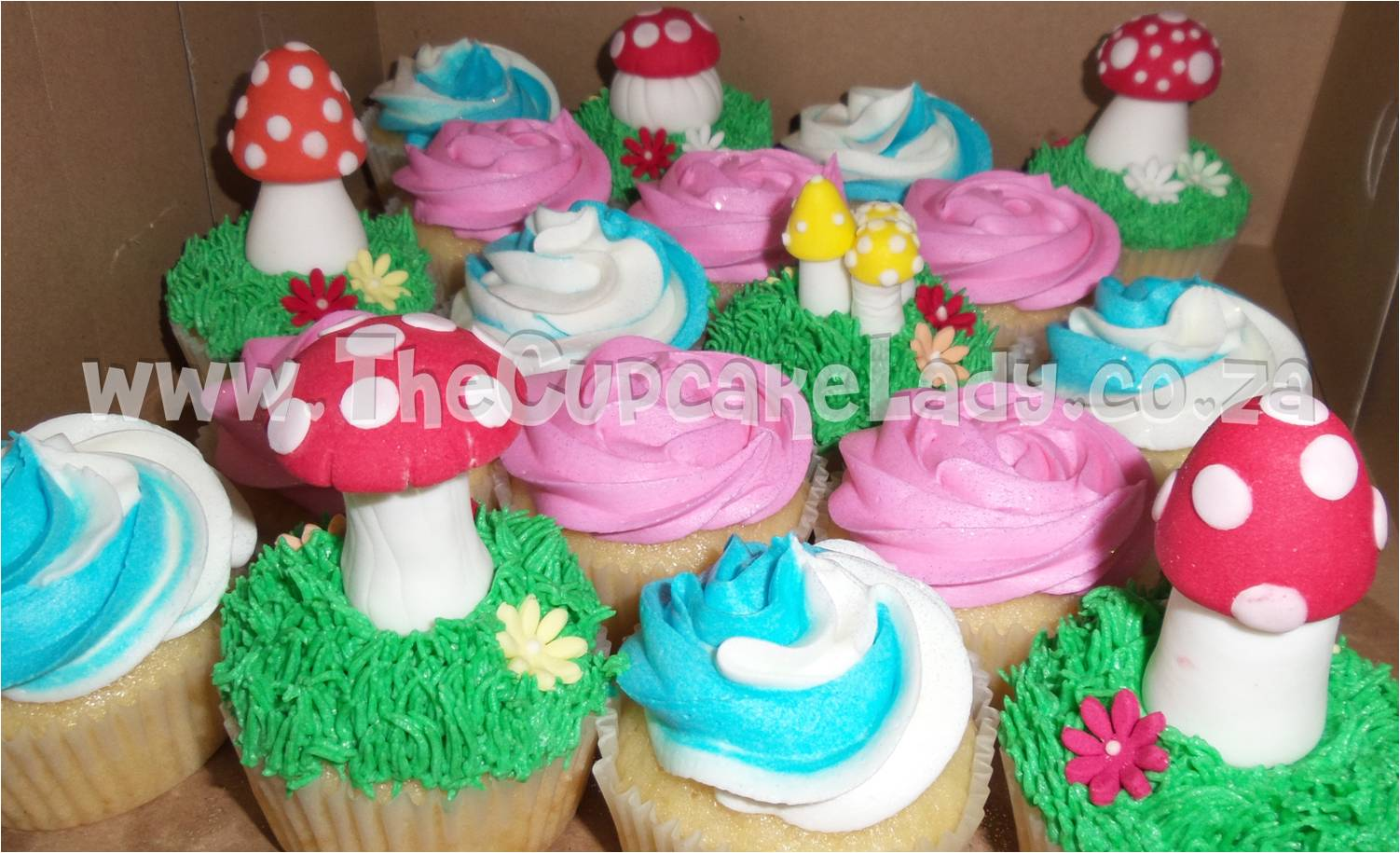 vanilla cupcakes, Smurf party, vanilla butter icing, hand made sugar paste toadstools