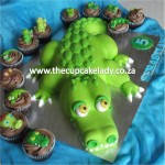 Cake artist, sugar artist, Vorna Valley, Midrand. 3D crocodile-shaped cake with custom made sugar paste crocodile cupcake toppers