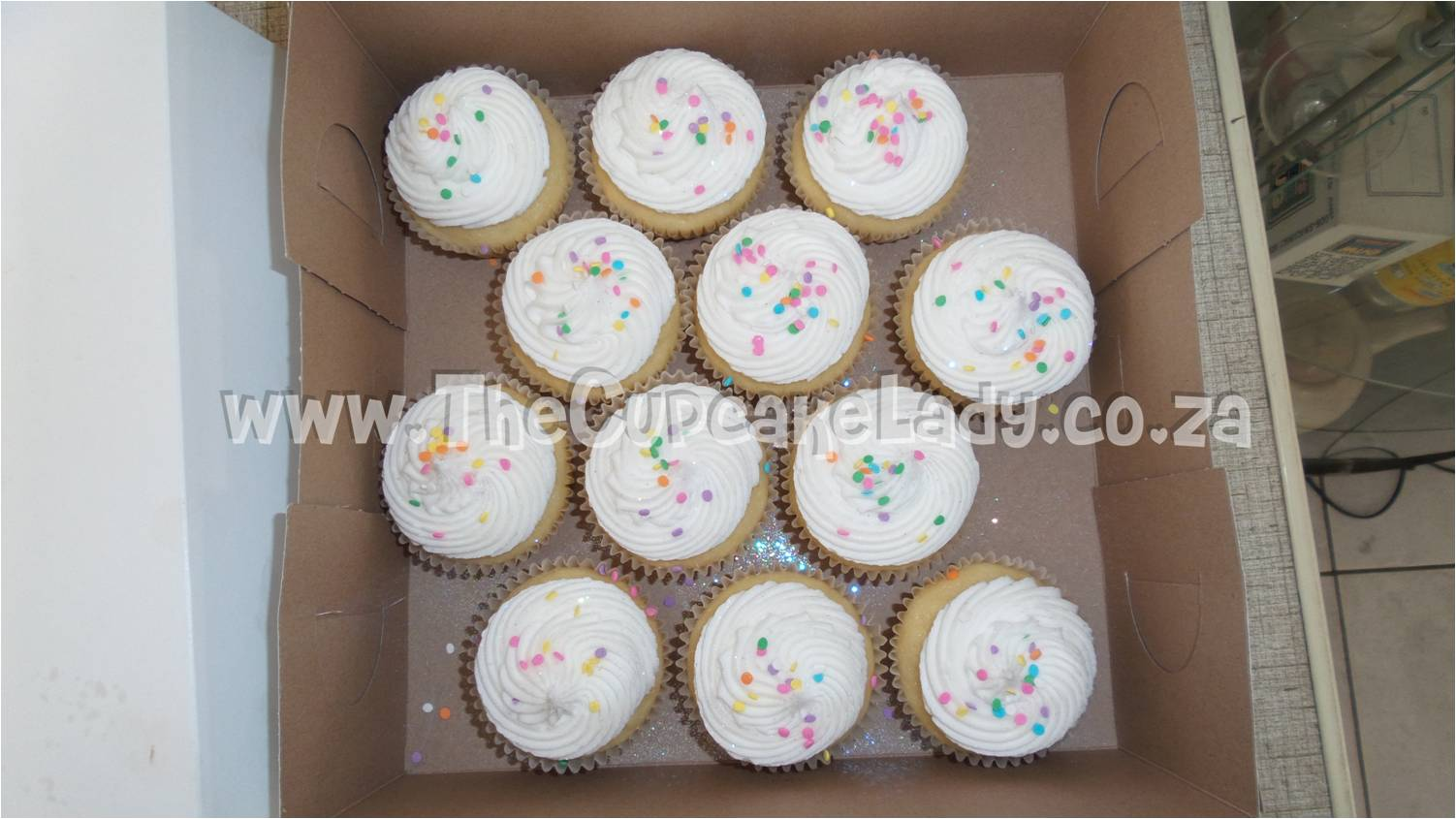 vanilla cupcakes with vanilla butter icing and confetti
