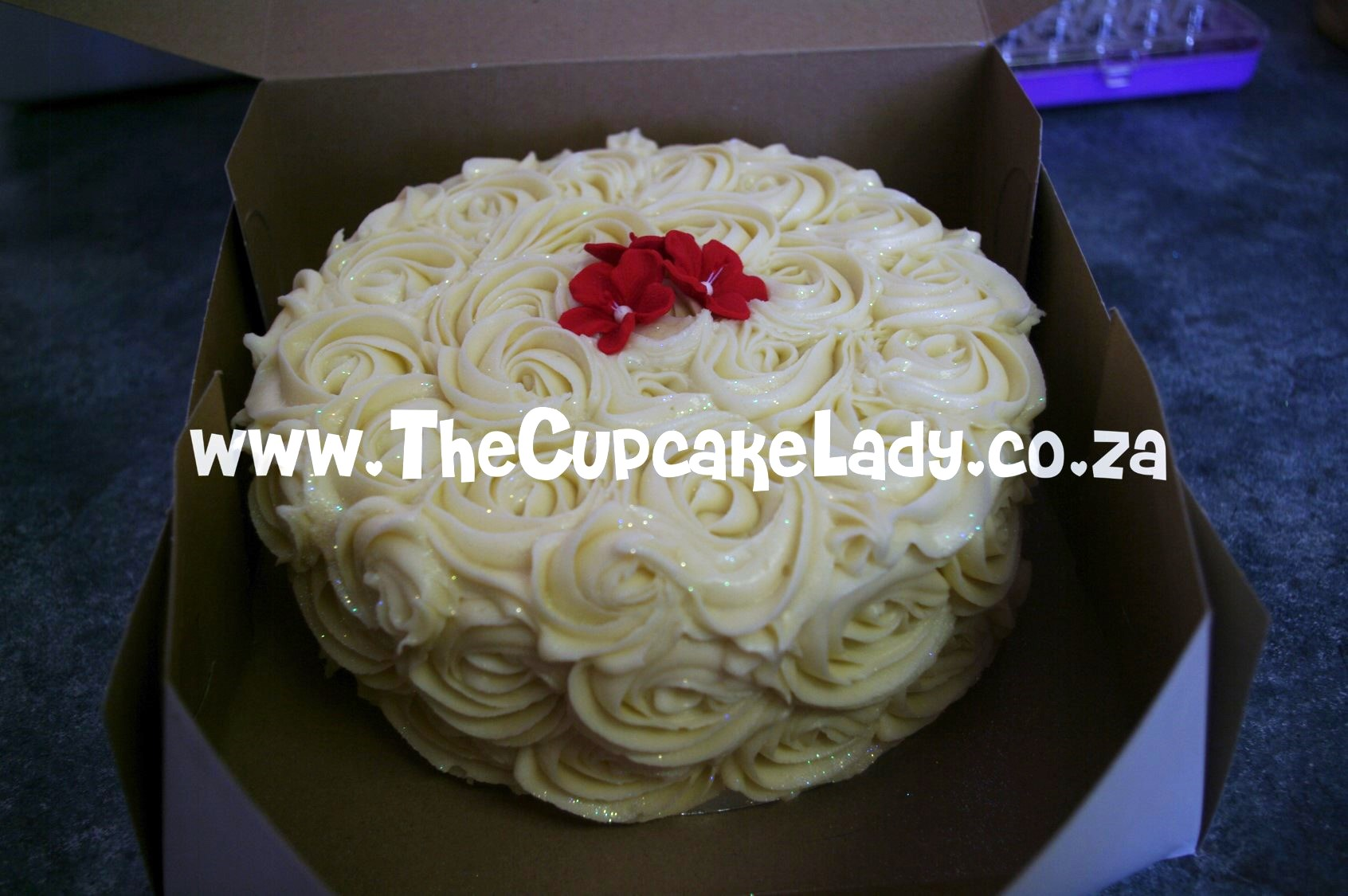 red velvet cake with cream cheese icing rosettes