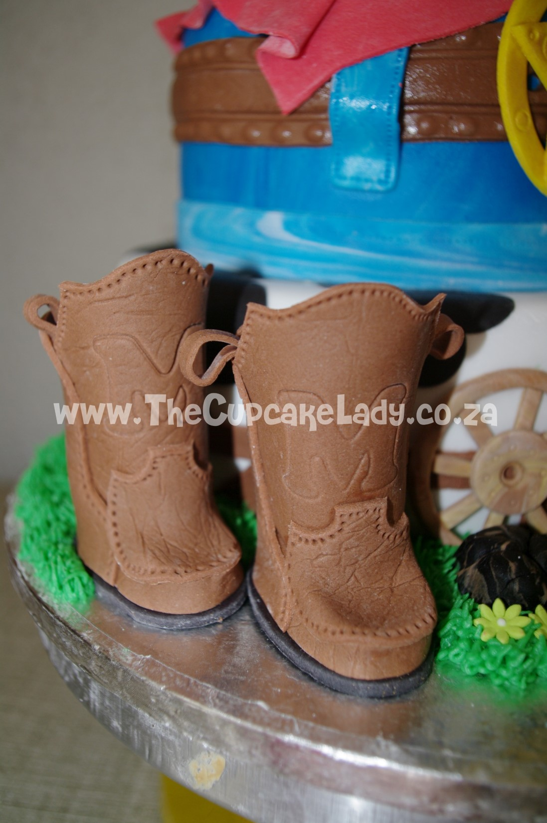 cowboy theme, western theme, two tier cake, birthday cake, custom made sugar paste fondant decorations - boots