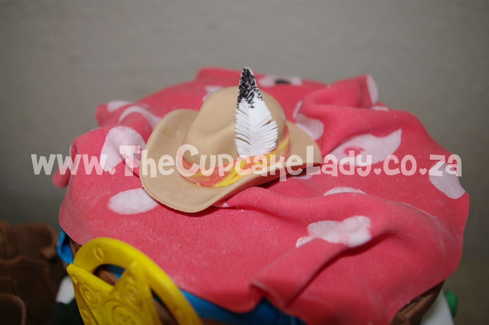cowboy theme, western theme, two tier cake, birthday cake, custom made sugar paste fondant decorations - bandana, stetson