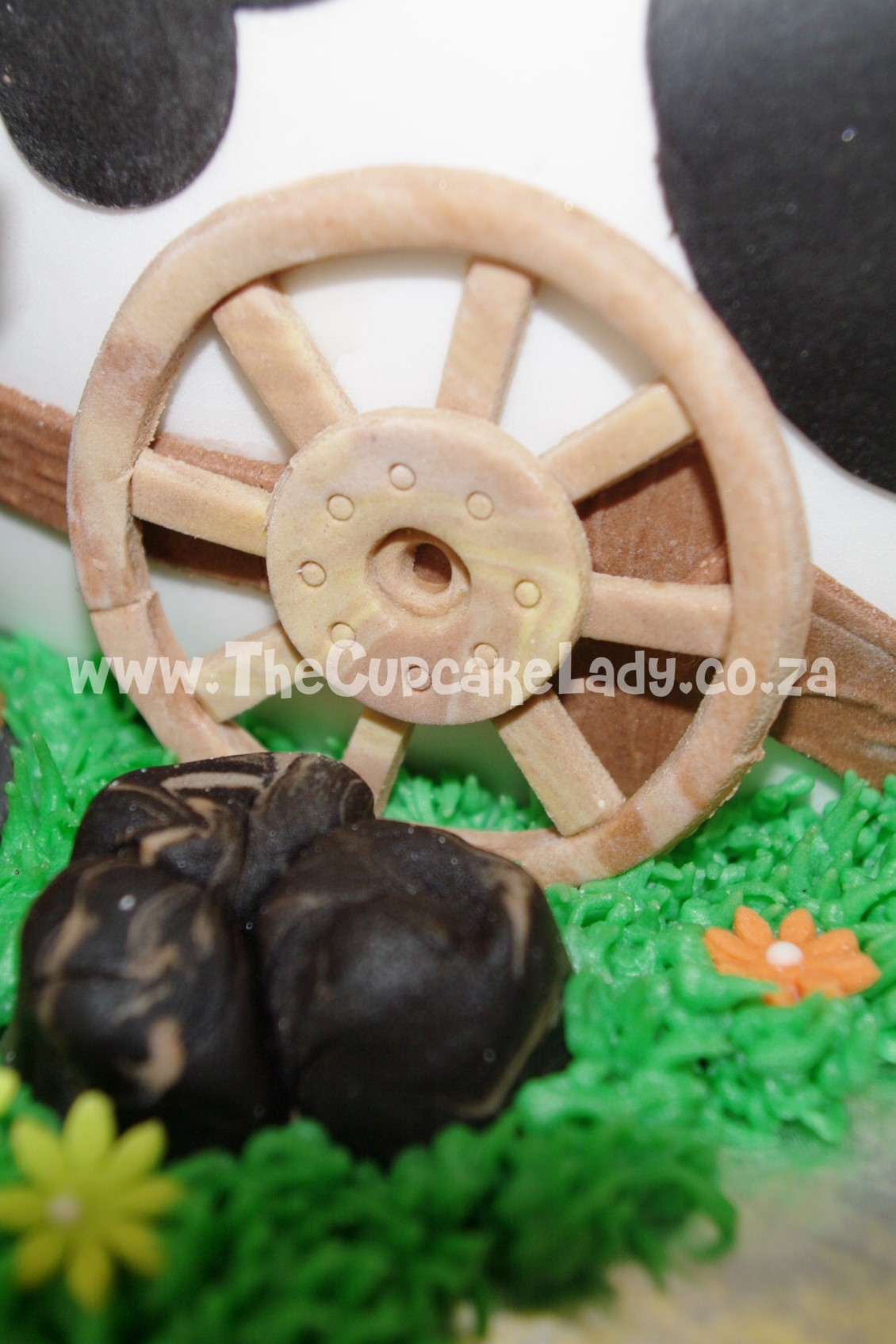 cowboy theme, western theme, two tier cake, birthday cake, custom made sugar paste fondant decorations - wagon wheel