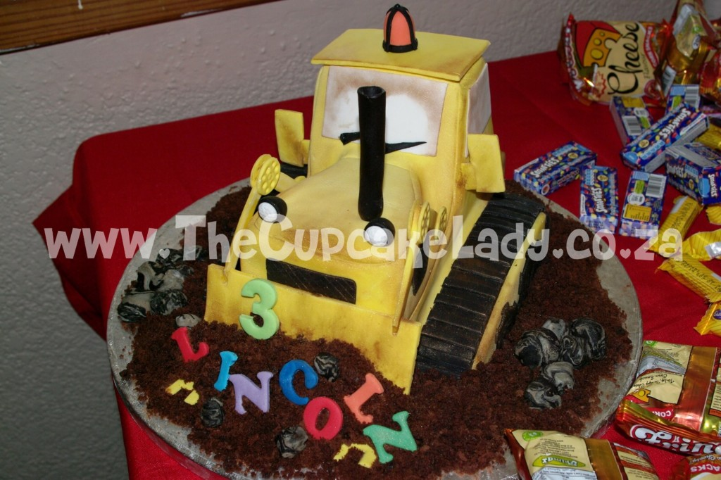 sculpted cake, novelty cake, vanilla cake with chocolate butter icing, bulldozer, grader, construction theme cake
