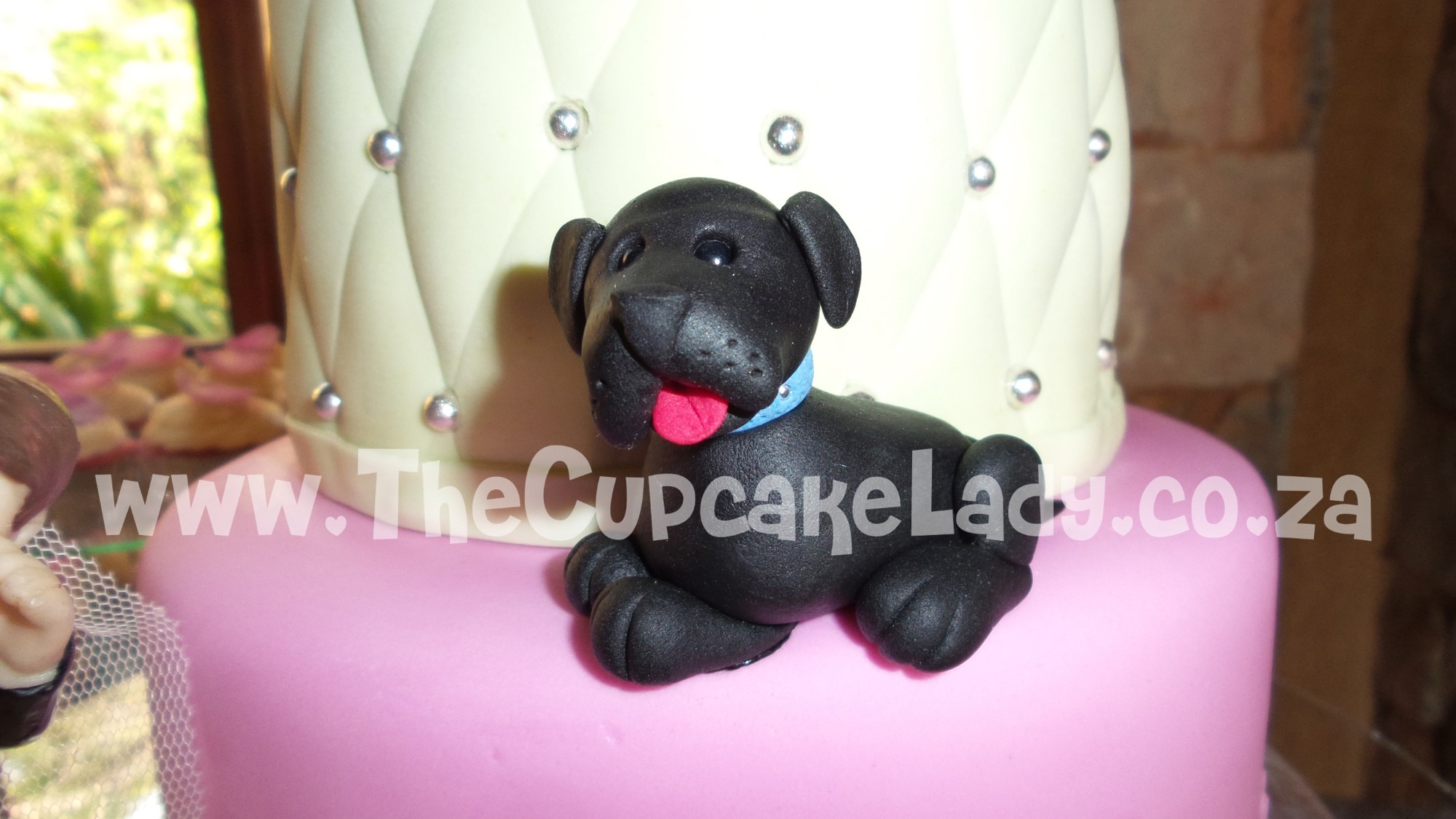 two tiered cake, chocolate and vanilla, pink velvet cupcakes, cream cheese icing, crystallised rose petal, sugar paste dog