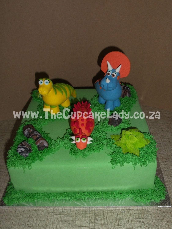 sugar paste dinosaurs, sugar paste rocks, sugar paste plants, cake toppers, birthday cake