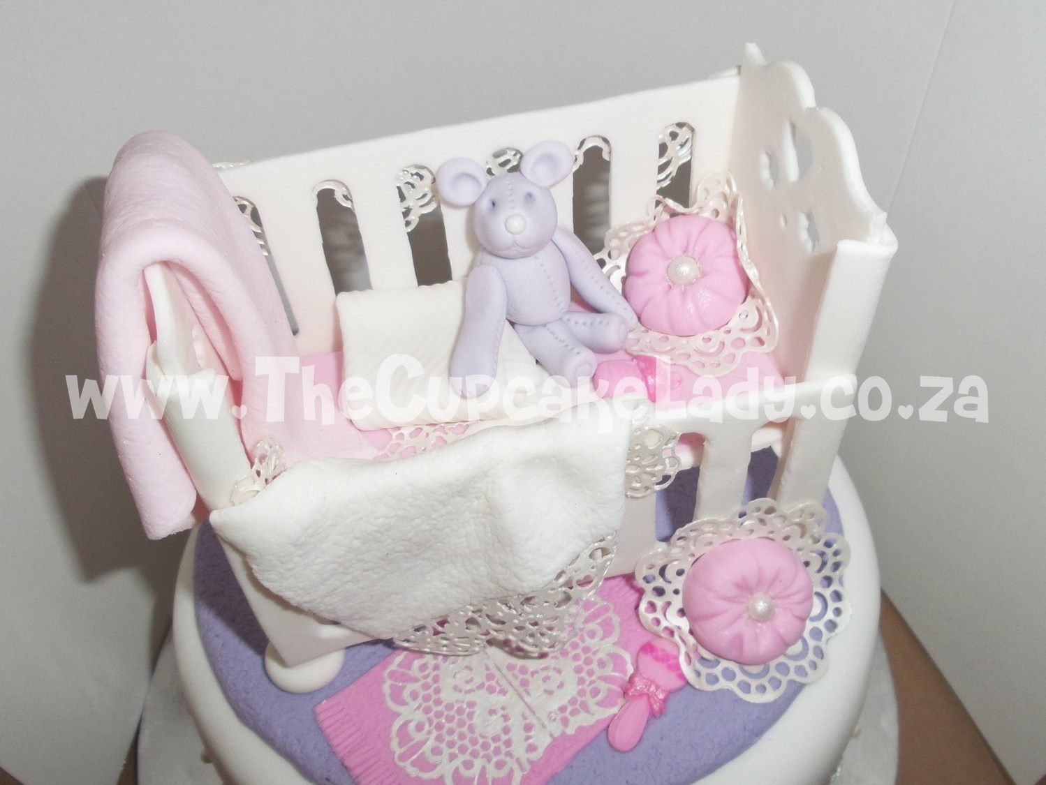 baby shower, nursery-theme, cake, cot and all its extras - the lace, blankets, cushions and all - are hand made of sugar paste and completely edible