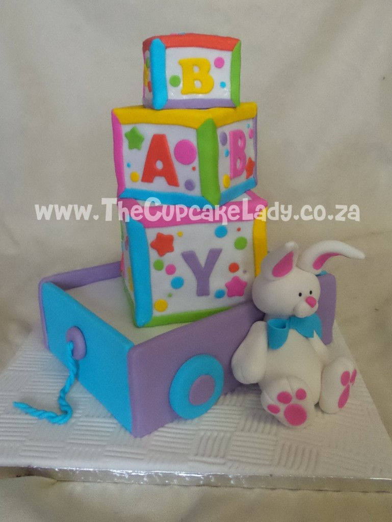 baby blocks, baby themed cake, baby cake, baby shower cake, baby blocks in a toy wagon with a toy bunny, debbie brown's baby cakes