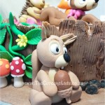 vanilla cake with vanilla butter icing, made to look like a tree stump and decorated with hand made sugar paste fox, fawn, hedgehog, and squirrel, for a woodland-themed baby shower