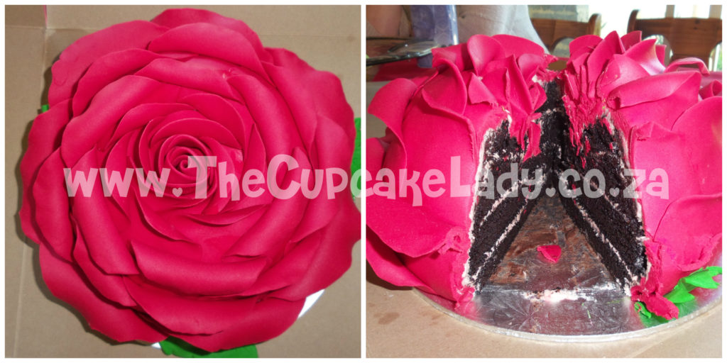 giant rose cake - layers of my delectable chocolate cake and a pale pink vanilla butter icing inside, covered in bright red sugar paste petals
