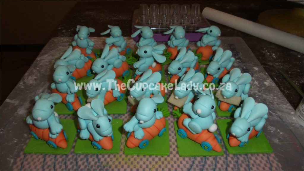 Sugar paste bunnies on carrot skateboards. The green squares are 6x6cm and I was terrified to touch their ears after they were assembled!! :P