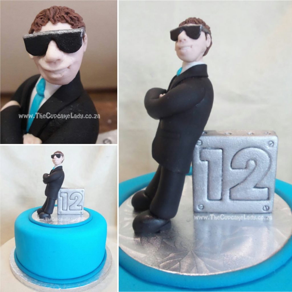 """Midrand cake artist, cupcakes, cakes and sugar art. Birthday boy wanted """"something cool"""" on his birthday cake, like a guy in a suit wearing sunglasses. I've been working on my faces, trying to make them more realistic when I want them to be, and I am very pleased with this one. Again – my proportions are a little off, but I think he looks """"cool""""!"""
