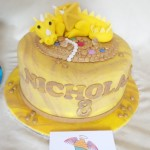 single tier vanilla cake, with a hand made sugar paste dragon and treasure as removable cake topper