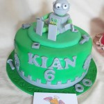 single tier chocolate cake, with a hand made sugar paste robot, nuts, bolts, washers and cogs as removable cake topper