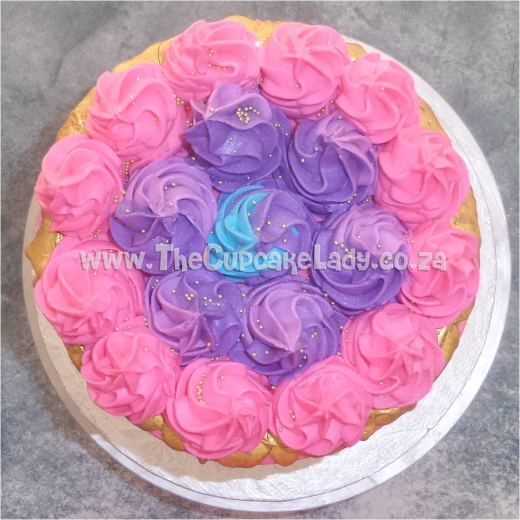 The Cake Was Then Covered With Blue Pink And Purple Butter Icing In Two Shades And The Bottom Had Some Confetti As Added Decoration